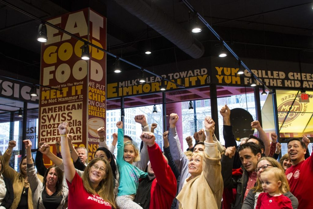 Tom & Chee grilled cheese franchise fans in the store