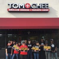 Tom & Chee franchise with workers