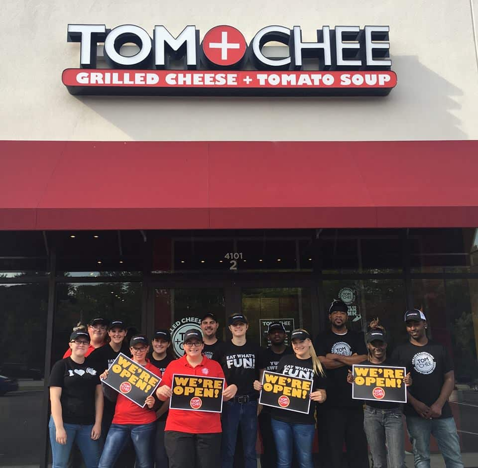 Tom & Chee grilled cheese franchise owner with workers