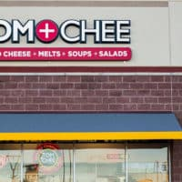 Tom & Chee storefront logo