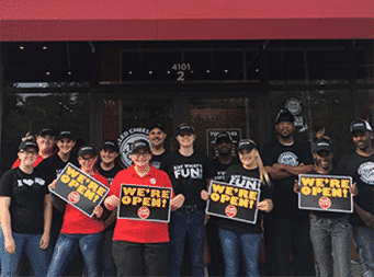 melt franchise Employees with we're open signs - Tom&Chee franchise opening